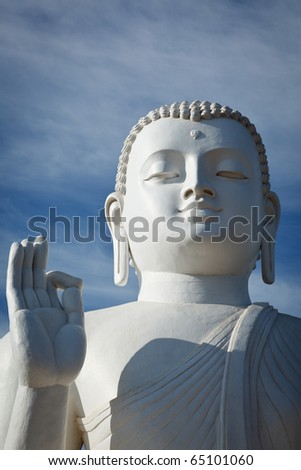 Closse up of white Buddha statue. Mihintale, Sri Lanka