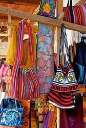Cloth bags souvenirs display in artisan market Antigua - Guatemala