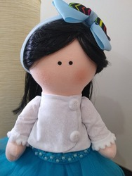Cloth doll with black hair and dress