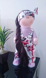 Cloth doll with clothes and long hair