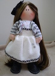 Cloth doll with dress and long blond hair
