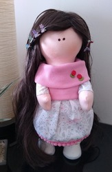 Cloth doll with long hair and pink dress
