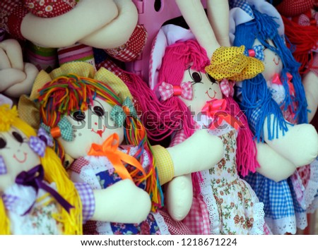 Cloth dolls representing different ethnicities and races, in street shop stalls #1218671224