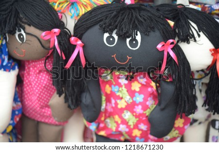 Cloth dolls representing different ethnicities and races, in street shop stalls #1218671230