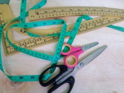 Cloth meter, elbow ruler, curved ruler, scissors, tools for making clothing patterns.