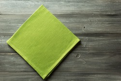 cloth napkin on rustic wooden background
