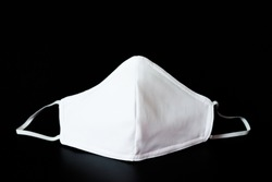 Cloth white mask isolated on black background - for prevent dust (PM 2.5),  disease (Coronavirus or COVID-19).