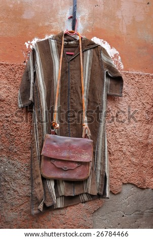 Clothes and leather bag for sale in the souk of Marrakesh,Morocco