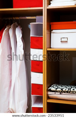 Clothes and towels in a wooden wardrobe