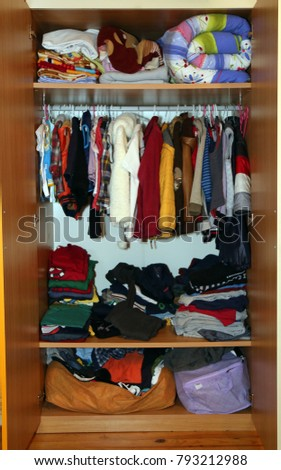 Clothes Closet And Colorful Sweaters