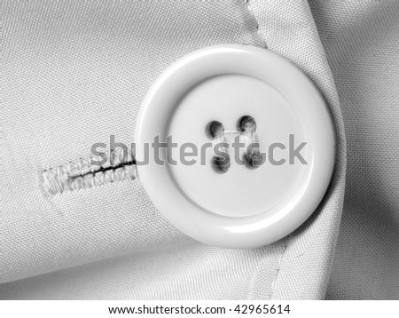 clothes fragment with button in black and white