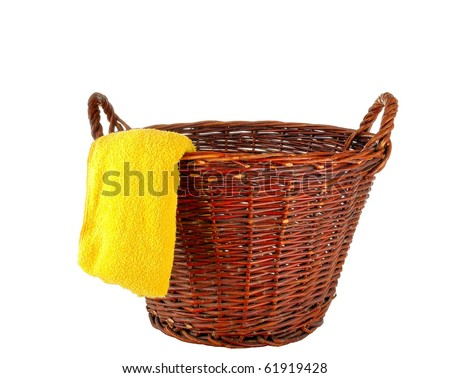 Clothes hamper  with yellow towel- isolated over white