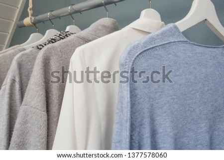 Row Of White Dress And Shirts Hanging In White Wardrobe Images And