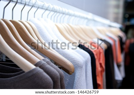 Clothes hang on a shelf in a designer clothes store in Melbourne, Australia