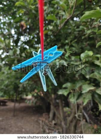 Clothes hanger closeup on a rope Stok fotoğraf ©