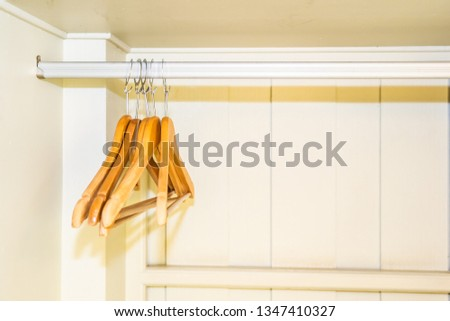 Clothes hanger with out clothes in closet