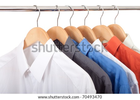 clothes hanger with shirts isolated on white - stock photo