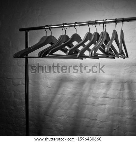 clothes hangers on a clothes rail