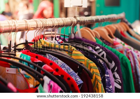 clothes hanging on a rail at a...