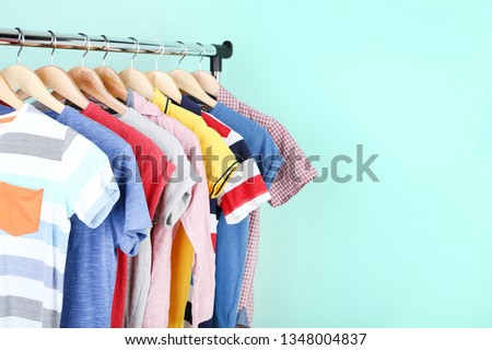 Clothes hanging on mint background #1348004837