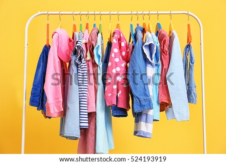 Clothes hanging on rack, closeup #524193919