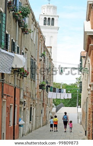 clothes hanging out to dry on a calle - stock photo