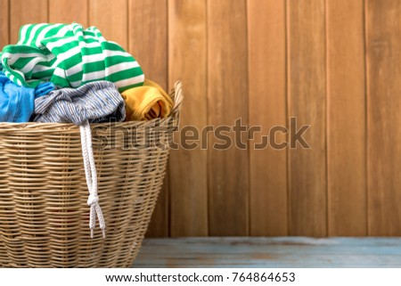 Shutterstock Clothes in a laundry wooden basket on wood table