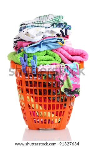 Clothes in orange plastic basket isolated on white