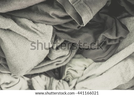 Clothes in washing machine.black and white Vintage tone.Selective focus.