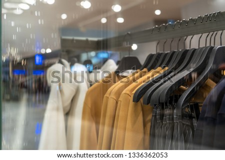 clothes line in glasses shop at shopping department store for shopping , business fashion and advertisement concept #1336362053