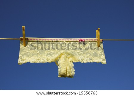 Clothes lingerie on washing laundry line blue skies