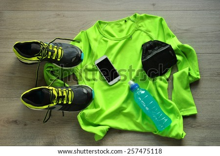 Clothes make running with isotonic drink phone and T-shirt