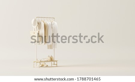 Clothes on a hanger, storage shelf in a cream background. Collection of clothes hanging on rack with neutral beige colors. 3d rendering, concept for shopping store and bedroom Foto d'archivio ©
