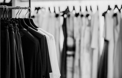 clothes on a rack in a store