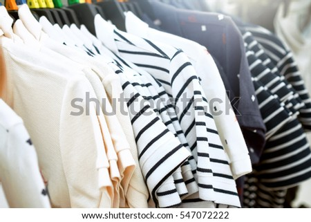 Clothes on clothes rail in clothing store #547072222
