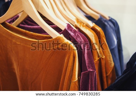 Clothes on clothes rail in clothing store #749830285