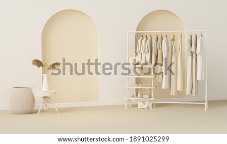 Clothes on grunge background, shelf on cream background. Collection of clothes hanging on a rack in neutral beige colors. 3d rendering, store and room concept Zdjęcia stock ©