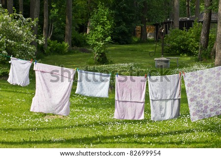 clothes on the backyard drying on the clothesline after washing stock