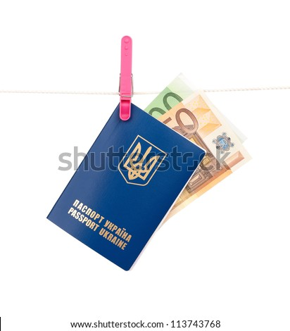 Clothes-peg holding international Ukrainian passport with Euro banknotes on a rope isolated on white background