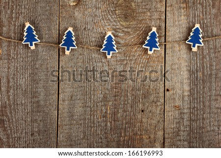 Clothes-peg in shape of Christmas tree on old wooden background