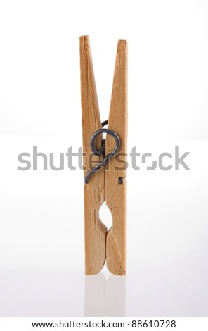 Clothes peg isolated with its reflection on white background.  Included clipping path, so you can easily cut it out and place over the top of a design.