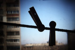 clothes-pegs on  string and sky, holga lens photography