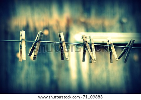 Clothes pins lined up on a wire.