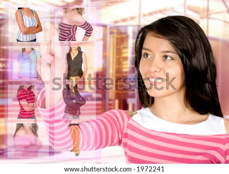 clothes shopping online - girl inside a retail clothes store choosing