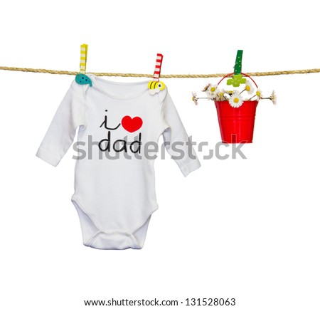 clothesline with a bib and baby clothes