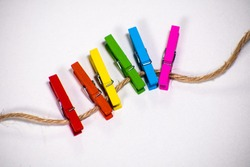 Clothesline with clothespins in the colors of the rainbow. Gay (LGBTQ+) theme.