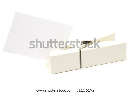 clothespin holding note isolated on white - stock photo