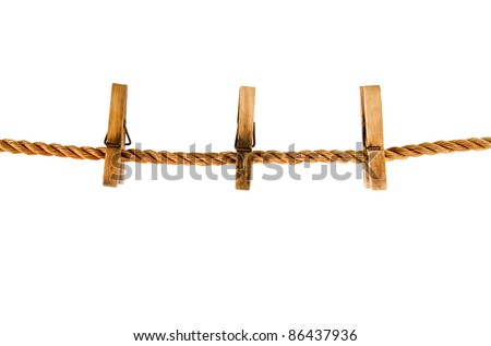 clothespins on a rope isolated on the white background