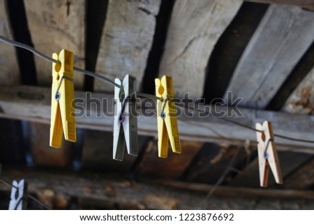 Clothespins on rope #1223876692