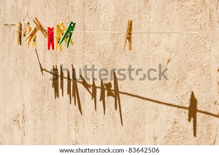 clothespins with shadows horizontal